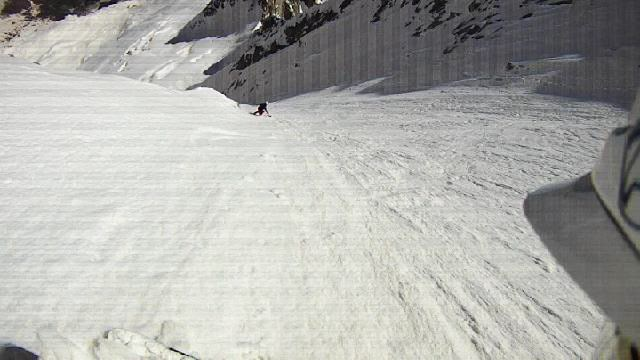 Mel skiing down...